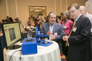 Dr. Adam Wax explains to President Price how Lumedica has made Optical Coherence Tomography (OCT) small and affordable.