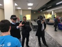 Ravi Bellamkonda, Vinik Dean of the Pratt School of Engineering at Duke University, takes a turn playing a virtual reality game on display during the Innovation Hub's grand opening event
