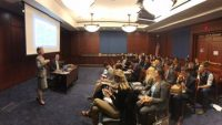 Robin Rasor speaking in DC in front of congressional staff and stakeholders
