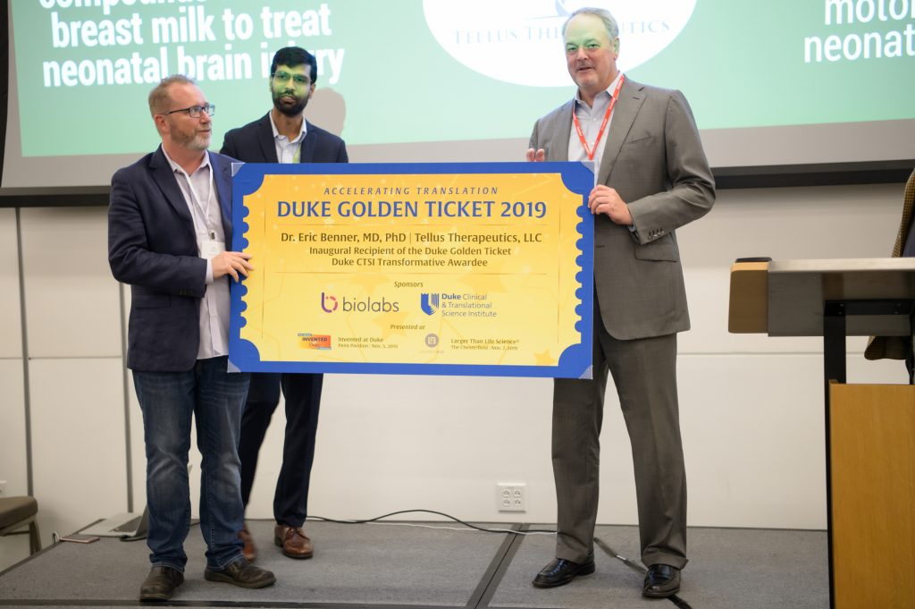 The first ever Duke Golden Ticket awarded to Dr. Eric Benner by Ed Field of NC BioLabs.